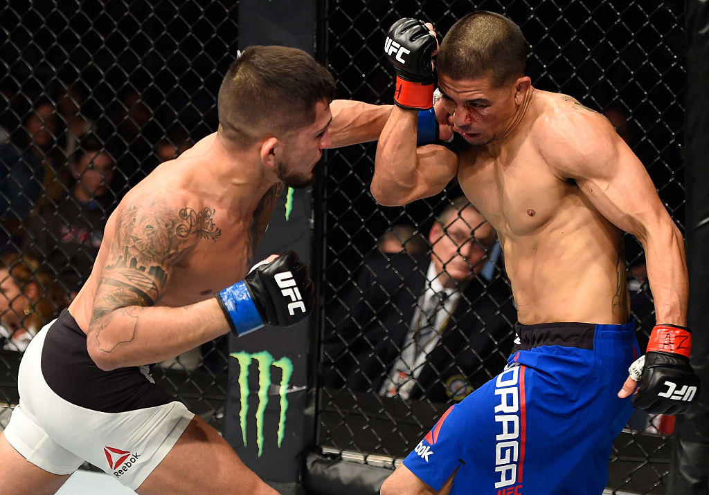 PHOENIX, AZ - JAN. 15: (L-R) Sergio Pettis punches John Moraga in their flyweight bout during the UFC Fight Night event inside Talking Stick Resort Arena. (Photo by Jeff Bottari/Zuffa LLC)