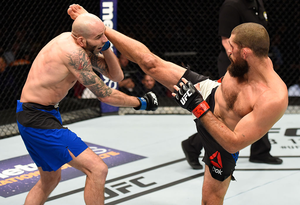 PHOENIX, AZ - JAN. 15: (R-L) Court McGee kicks Ben Saunders in their welterweight bout during the UFC Fight Night event inside Talking Stick Resort Arena. (Photo by Jeff Bottari/Zuffa LLC)
