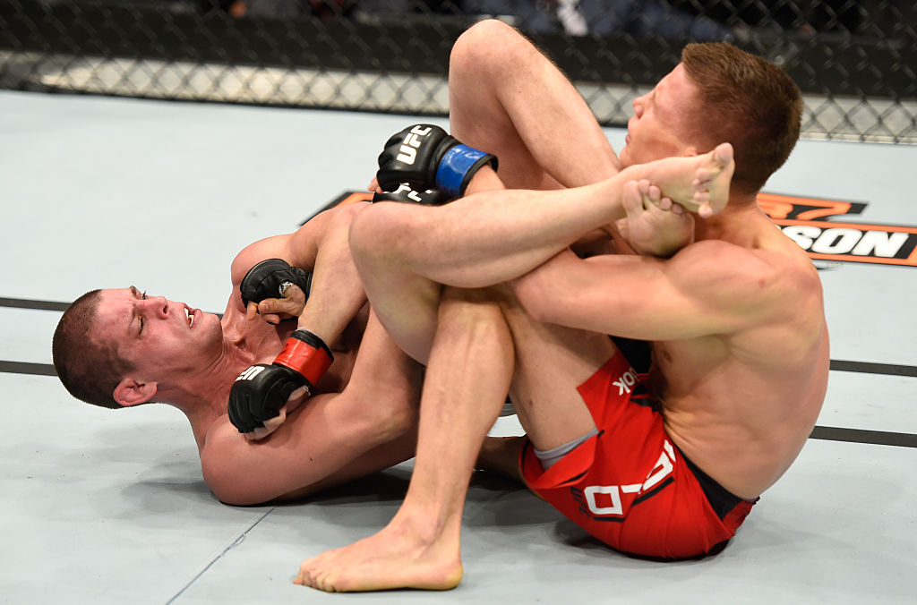 PHOENIX, AZ - JAN. 15: (L-R) Joe Lauzon attempts to submit Marcin Held of Poland in their lightweight bout during the UFC Fight Night event inside Talking Stick Resort Arena. (Photo by Jeff Bottari/Zuffa LLC)