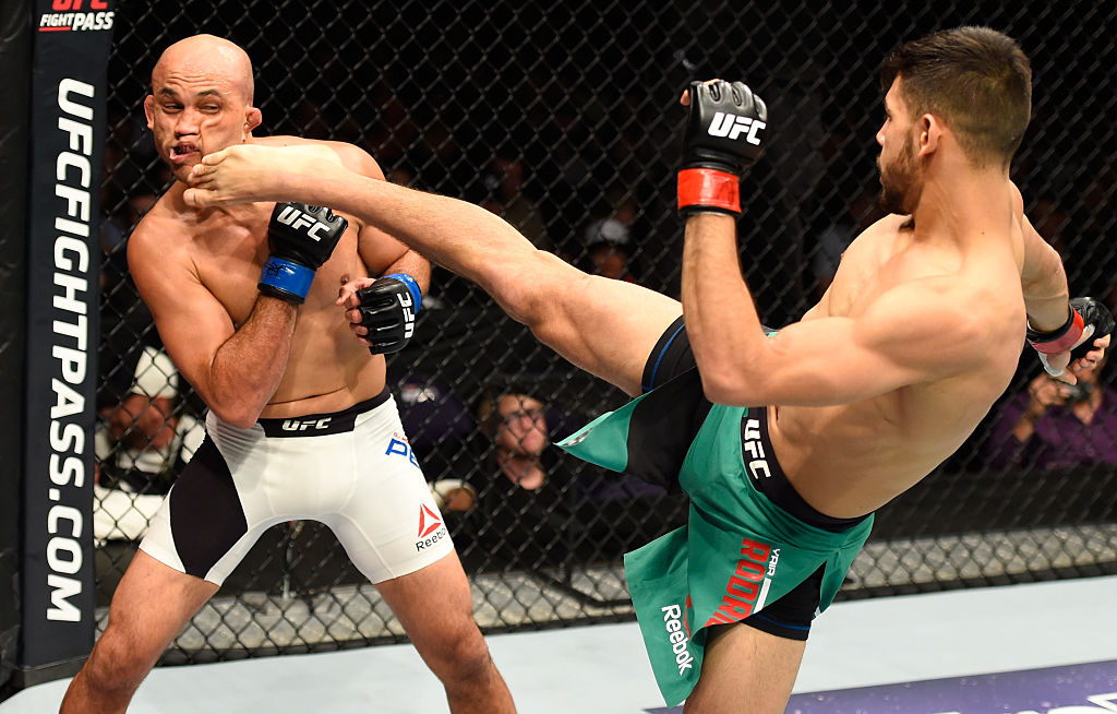 PHOENIX, AZ - JAN. 15: (R-L) Yair Rodriguez of Mexico kicks BJ Penn in their featherweight bout during the UFC Fight Night event inside Talking Stick Resort Arena. (Photo by Jeff Bottari/Zuffa LLC)
