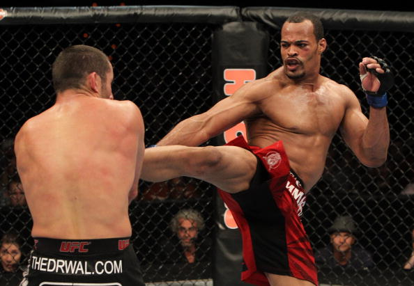 (R-L) David Branch kicks Tomasz Drwal at UFC Fight Night at the Frank Irwin Center on September 15, 2010 in Austin, Texas.  (Photo by Josh Hedges/Zuffa LLC)