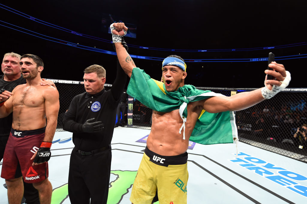 PITTSBURGH, PA - SEPTEMBER 16: (R-L) <a href='../fighter/Gilbert-Burns'>Gilbert Burns</a> of Brasil celebrates after knocking out <a href='../fighter/Jason-Saggo'>Jason Saggo</a> of Canada in their lightweight bout during the <a href='../event/UFC-Silva-vs-Irvin'>UFC Fight Night </a>event inside the PPG Paints Arena on September 16, 2017 in Pittsburgh, Pennsylvania. (Photo by Josh Hedges/Zuffa LLC/Zuffa LLC via Getty Images)