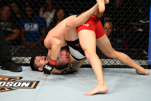 Brandon Moreno attempts to submit Louis Smolka during his UFC debut