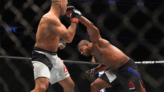 ORLANDO, FL - DECEMBER 19:   (R-L) Alistair Overeem punches Junior dos Santos in their heavyweight bout during the UFC Fight Night event at the Amway Center on December 19, 2015 in Orlando, Florida. (Photo by Jeff Bottari/Zuffa LLC)