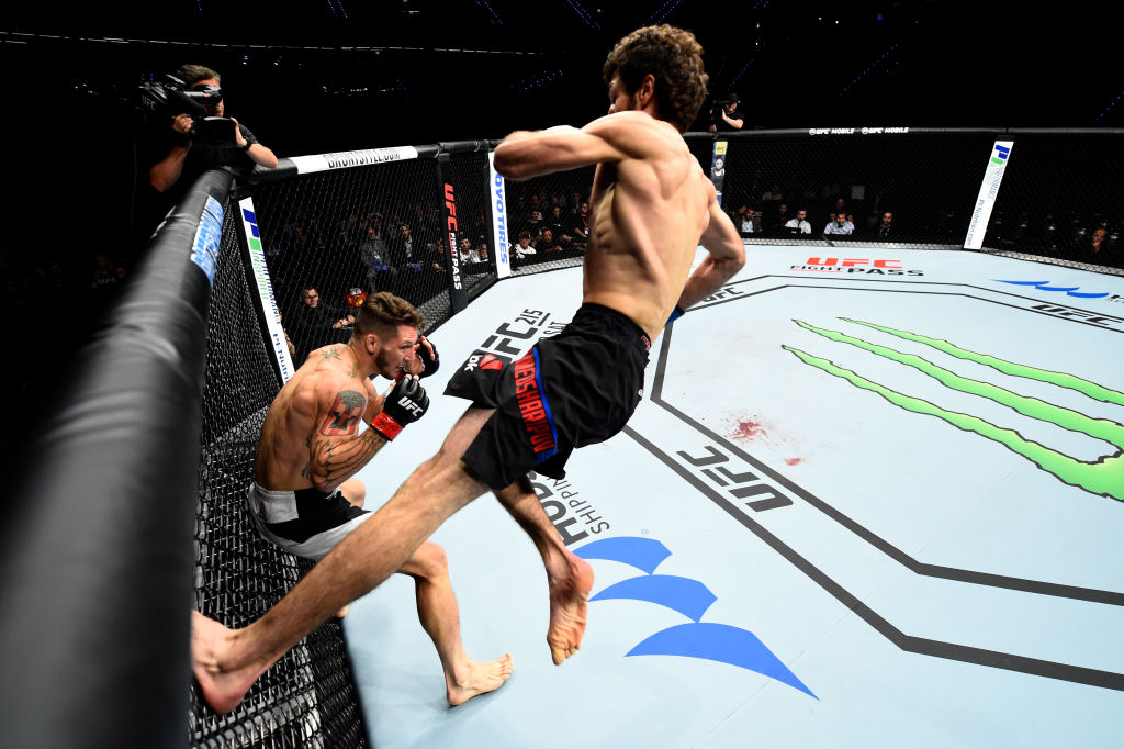 ROTTERDAM, NETHERLANDS - SEPTEMBER 02: (R-L) Zabit Magomedsharipov of Russia jumps off the wall of the Octagon to kick Mike Santiago in their featherweight bout during the UFC Fight Night event at the Rotterdam Ahoy on September 2, 2017 in Rotterdam, Netherlands. (Photo by Josh Hedges/Zuffa LLC)