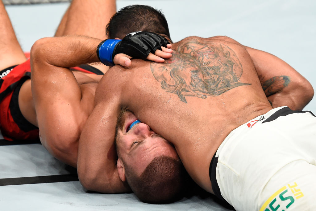 ROTTERDAM, NETHERLANDS - SEPTEMBER 02:  (R-L) Michel Prazeres of Brazil submits Mads Burnell of Denmark with a north-south choke submission in their lightweight bout during the UFC Fight Night event at the Rotterdam Ahoy on September 2, 2017 in Rotterdam, Netherlands. (Photo by Josh Hedges/Zuffa LLC)