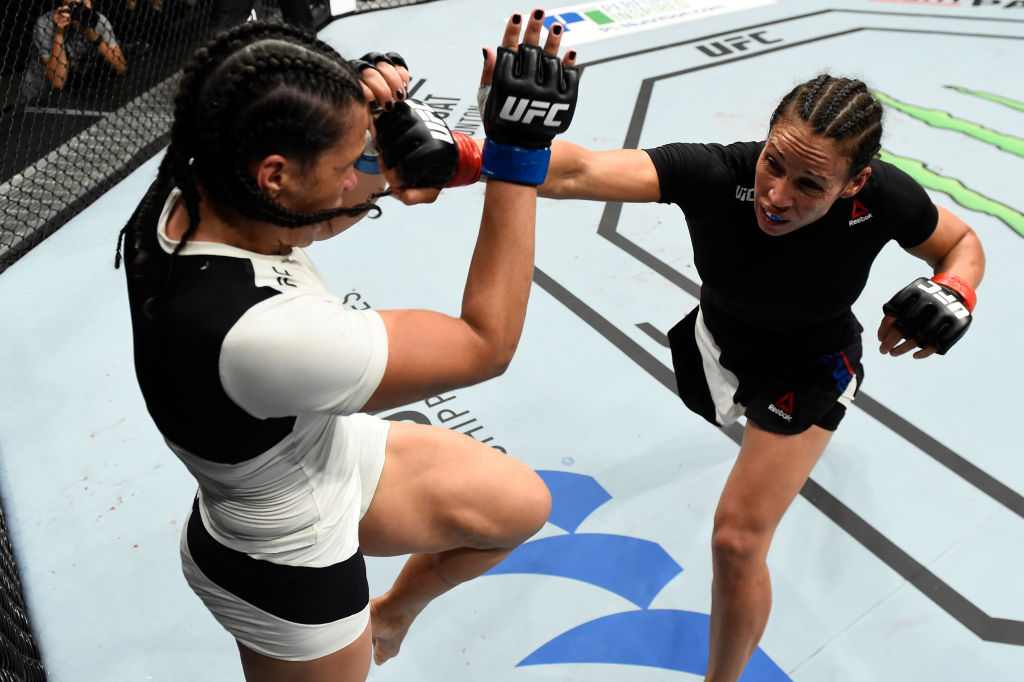 ROTTERDAM, NETHERLANDS - SEPTEMBER 02: (R-L) Marion Reneau punches Talita Bernardo of Brazil in their women's bantamweight bout during the UFC Fight Night event at the Rotterdam Ahoy on September 2, 2017 in Rotterdam, Netherlands. (Photo by Josh Hedges/Zuffa LLC)