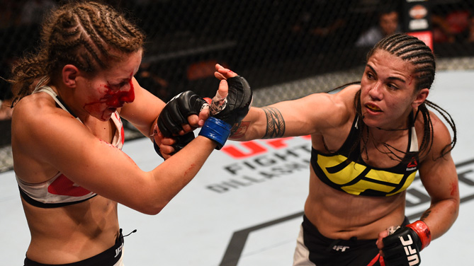 Jessica Andrade of Brazil punches Sarah Moras of Canada in their women's bantamweight bout during the UFC event at the Valley View Casino Center on July 15, 2015 in San Diego, California. (Photo by Jeff Bottari/Zuffa LLC)