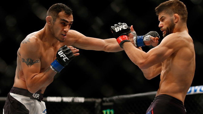 <a href='../fighter/Tony-Ferguson'>Tony Ferguson</a> punches <a href='../fighter/Josh-Thomson'>Josh Thomson</a> in their lightweight bout during the UFC event at the Valley View Casino Center on July 15, 2015 in San Diego, California. (Photo by Todd Warshaw/Zuffa LLC)