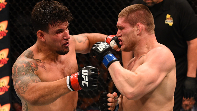 <a href='../fighter/Frank-Mir'>Frank Mir</a> punches <a href='../fighter/Todd-Duffee'>Todd Duffee</a> in their heavyweight bout during the UFC event at the Valley View Casino Center on July 15, 2015 in San Diego, California. (Photo by Jeff Bottari/Zuffa LLC)
