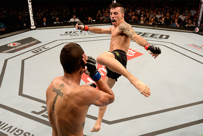 Thomas Almeida of Brazil kicks Anthony Birchak of the United States in their bantamweight bout during the UFC Fight Night Belfort v Henderson at Ibirapuera Gymnasium on November 7, 2015 in Sao Paulo, Brazil.  (Photo by Buda Mendes/Zuffa LLC)