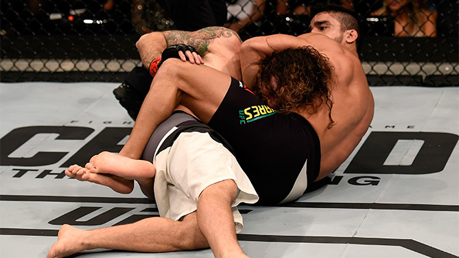 Thiago Tavares of Brazil submits Clay Guida of the United States in their featherweight bout during the UFC Fight Night Belfort v Henderson at Ibirapuera Gymnasium on November 7, 2015 in Sao Paulo, Brazil. (Photo by Buda Mendes/Zuffa LLC)