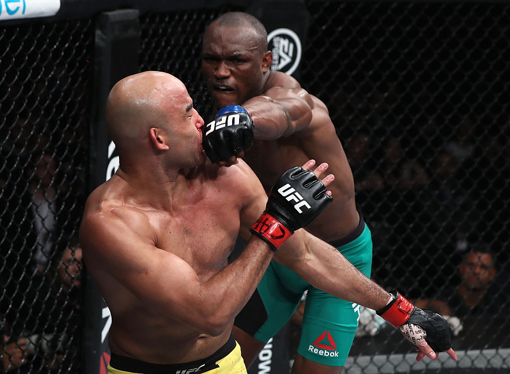 SAO PAULO, BRAZIL - NOVEMBER 19: <a href='../fighter/kamarudeen-usman'>Kamaru Usman</a> of Nigeria punches <a href='../fighter/warlley-alves'>Warlley Alves</a> of Brazil during their welterweight bout at the UFC Fight Night Bader v Minotouro at Ibirapuera Gymnasium on November 19, 2016 in Sao Paulo, Brazil. (Photo by Buda Mendes/Zuffa LLC)