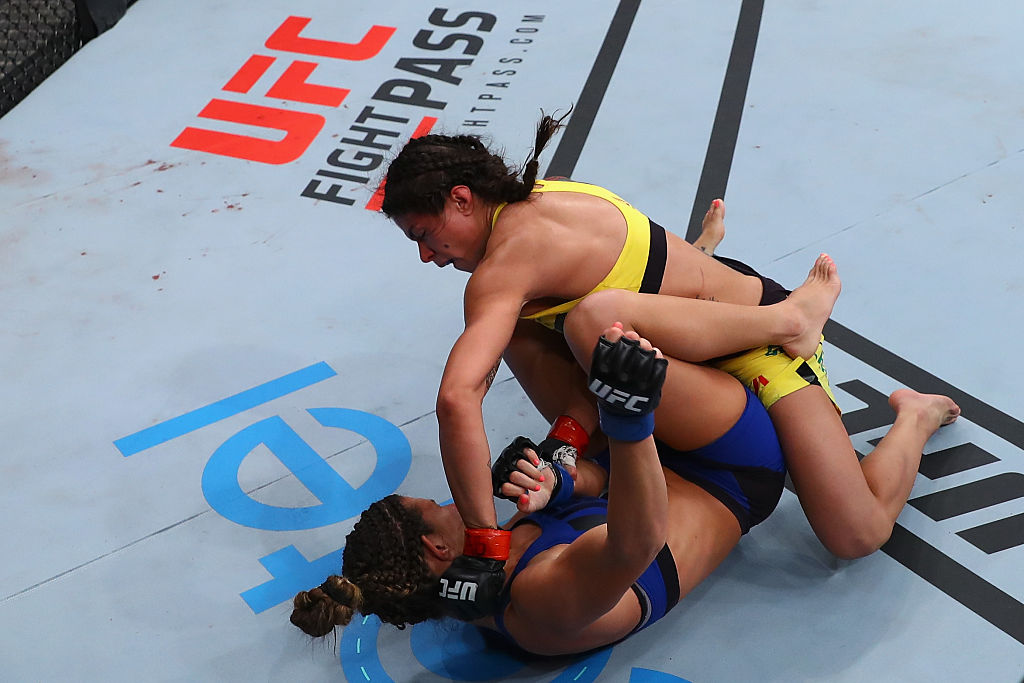 SAO PAULO, BRAZIL - NOVEMBER 19:  <a href='../fighter/Claudia-Gadelha'>Claudia Gadelha</a> of Brazil punches <a href='../fighter/cortney-casey'>Cortney Casey</a> of the United States during their women's strawweight bout at the <a href='../event/UFC-Silva-vs-Irvin'>UFC Fight Night </a>Bader v Minotouro at Ibirapuera Gymnasium on November 19, 2016 in Sao Paulo, Brazil.  (Photo by Buda Mendes/Zuffa LLC)