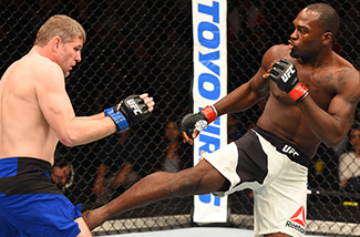 (R-L) Derek Brunson kicks <a href='../fighter/Dan-Kelly'><a href='../fighter/Dan-Kelly'>Daniel Kelly</a></a> of Australia in their middleweight fight during the UFC Fight Night event at the Spark Arena on June 11, 2017 in Auckland, New Zealand. (Photo by Josh Hedges/Zuffa LLC)