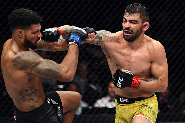 <a href='../fighter/elizeu-zaleski-dos-santos'><a href='../fighter/elizeu-zaleski-dos-santos'>Elizeu Zaleski dos Santos</a></a> of Brazil punches <a href='../fighter/max-griffin'><a href='../fighter/max-griffin'>Max Griffin</a></a> in their welterweight bout during the UFC Fight Night event inside the Ibirapuera Gymnasium on October 28, 2017 in Sao Paulo, Brazil. (Photo by Josh Hedges/Zuffa LLC)
