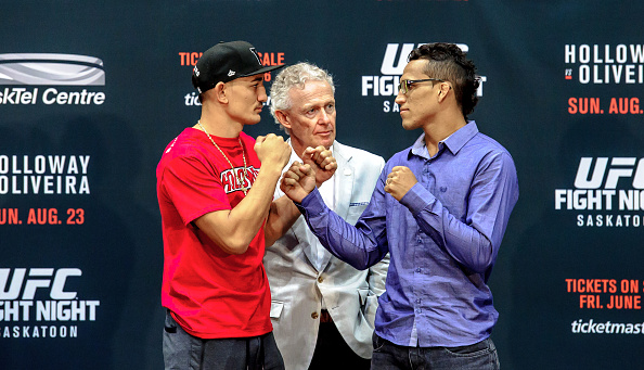 Max Holloway (L) and Charles Oliveira (R) square off at a press conference at the SaskTel Centre, June 24, 2015 in Saskatoon, Saskatchewan, Canada. (Photo by Steve Hiscock/Getty images)
