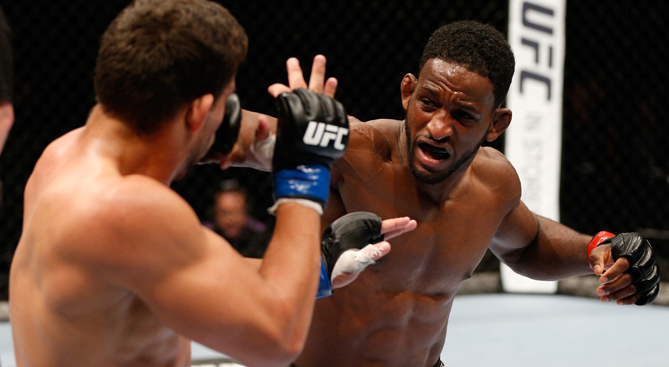 Neil Magny in action versus <a href='../fighter/Rodrigo-de-Lima'>Rodrigo de Lima</a> during <a href='../event/UFC-Silva-vs-Irvin'><a href='../event/saturday-december-11'>UFC Fight Night </a></a>event at Vector Arena on June 28, 2014 in Auckland, New Zealand.  (Photo by Josh Hedges/Zuffa LLC)