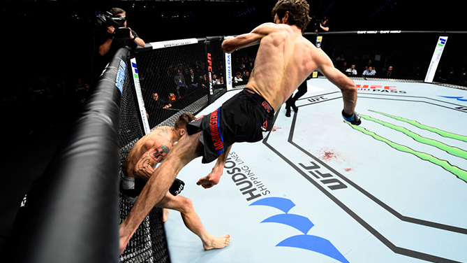 ROTTERDAM, NETHERLANDS - SEPTEMBER 02:  (R-L) Zabit Magomedsharipov of Russia lands a kick to the head of Mike Santiago in their featherweight bout during the UFC Fight Night event at the Rotterdam Ahoy on September 2, 2017 in Rotterdam, Netherlands. (Photo by Josh Hedges/Zuffa LLC)