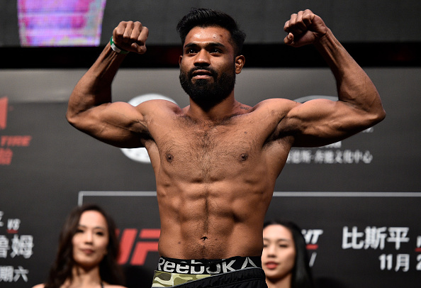 SHANGHAI, CHINA - NOVEMBER 24: <a href='../fighter/Bharat-Kandare'>Bharat Kandare</a> of India poses on the scale during the <a href='../event/UFC-Silva-vs-Irvin'>UFC Fight Night </a>weigh-in on November 24, 2017 in Shanghai, China. (Photo by Brandon Magnus/Zuffa LLC via Getty Images)