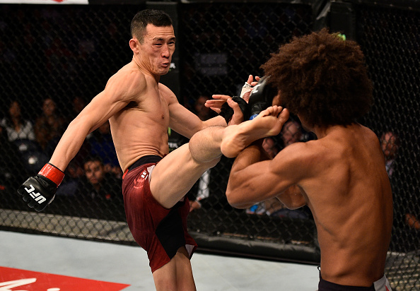 SHANGHAI, CHINA - NOVEMBER 25:  (L-R) Wang Guan of China kicks Alex Caceres in their featherweight bout during the UFC Fight Night event inside the Mercedes-Benz Arena on November 25, 2017 in Shanghai, China. (Photo by Brandon Magnus/Zuffa LLC via Getty Images)