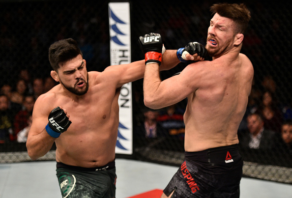 SHANGHAI, CHINA - NOVEMBER 25: Kelvin Gastelum punches Michael Bisping of England in their middleweight bout during the UFC Fight Night event inside the Mercedes-Benz Arena on November 25, 2017 in Shanghai, China. (Photo by Brandon Magnus/Zuffa LLC)
