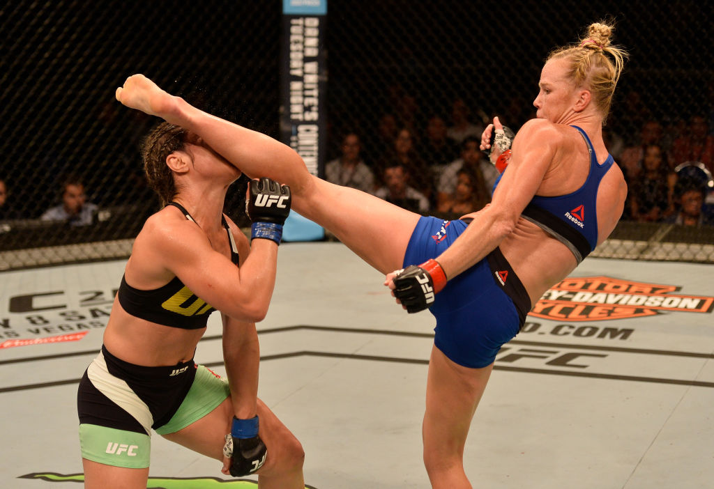 Holly Holm kicks Bethe Correia during their bout at Fight Night Singapore