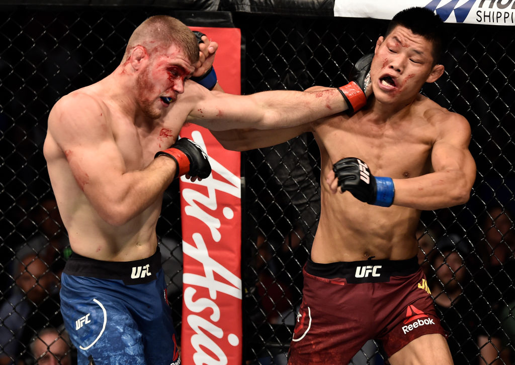 Jake Matthews & Li Jingliang fought in Perth at UFC 221. They'll both be featured in separate bouts on the Fight Night Singapore card (Photo by Jeff Bottari/Zuffa LLC)