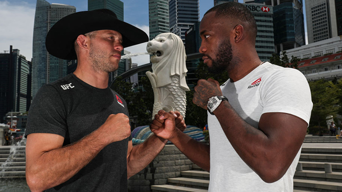 <a href='../fighter/Donald-Cerrone'>Donald Cerrone</a> (L) and <a href='../fighter/leon-edwards'>Leon Edwards</a> pose for a photo at the Merlion Park, overlooking the financial district, on April 25, 2018 in Singapore. (Photo by Yong Teck Lim/Zuffa LLC)