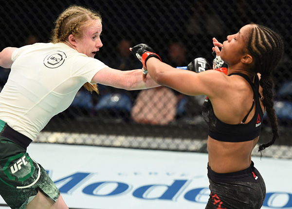 ST. LOUIS, MO - JANUARY 14: (L-R) JJ Aldrich punches Danielle Taylor in their women's strawweight bout during the UFC Fight Night event inside the Scottrade Center on January 14, 2018 in St. Louis, Missouri. (Photo by Josh Hedges/Zuffa LLC)