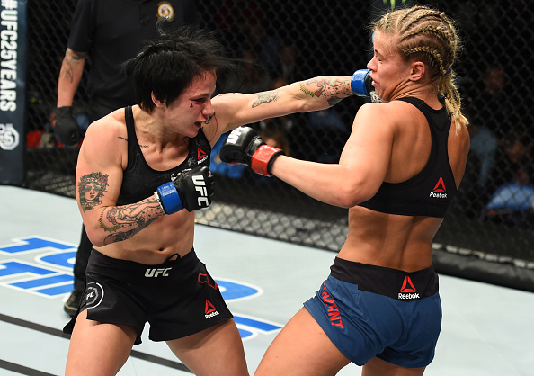 Jessica-Rose Clark punches Paige VanZant during their flyweight bout at Fight Night St. Louis