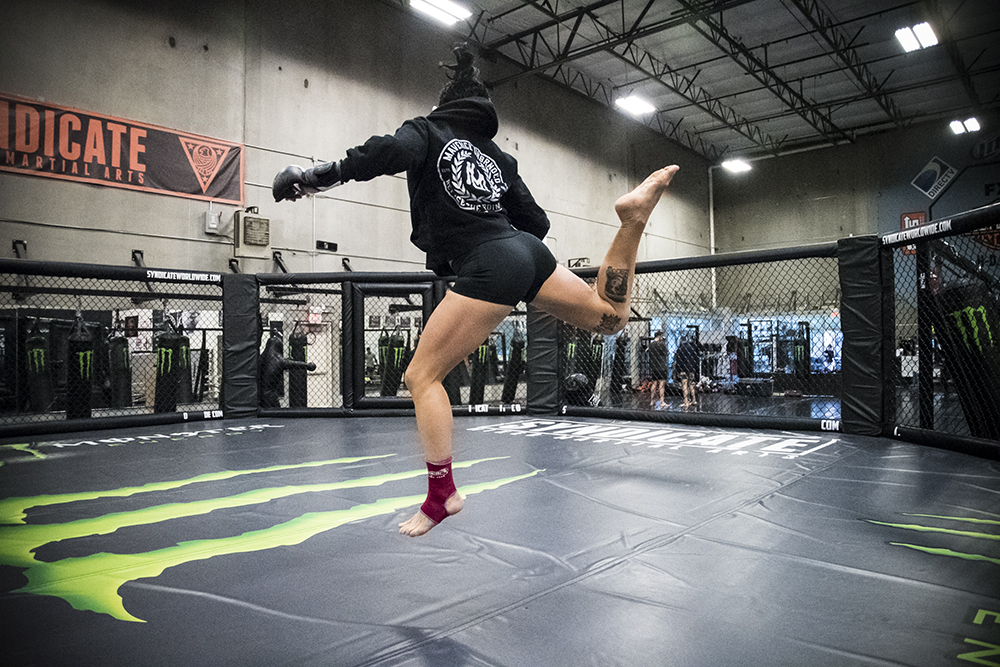 Jessica jokes throwing a flying spin kick before her sparring session begins.