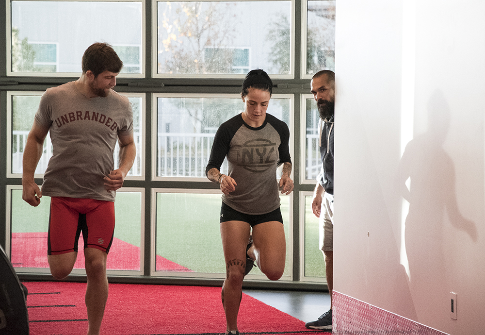 Bo Sandoval, Director of Strength & Conditioning at the UFC Performance Institute conducts Andrew Sanchez and Jessica-Rose Clark routine.