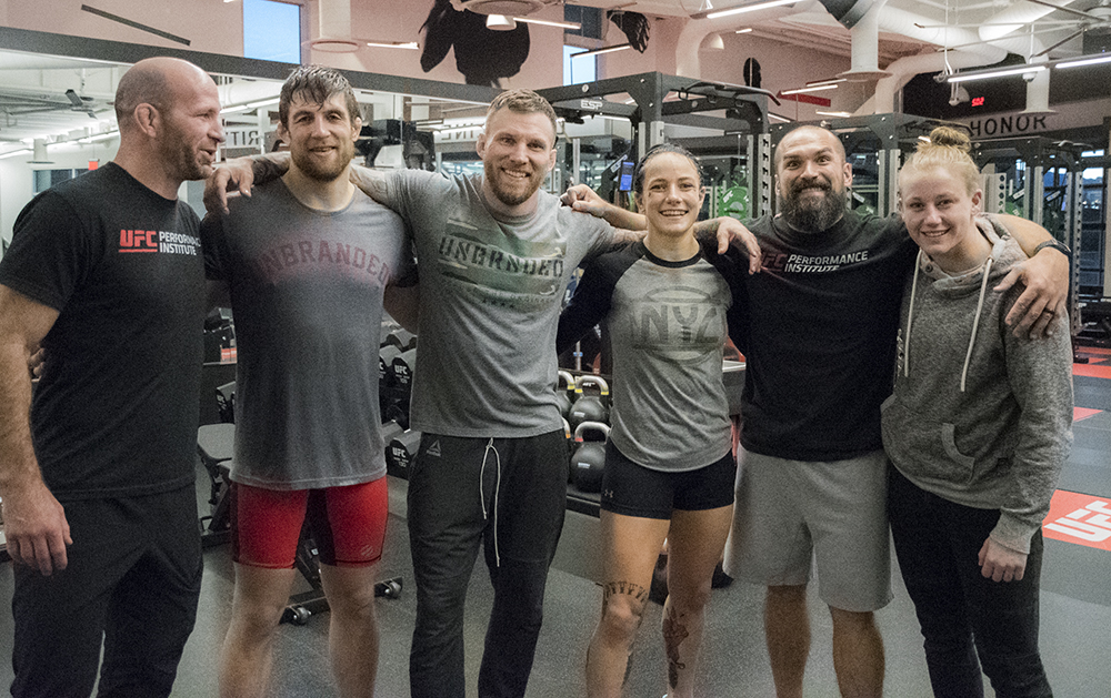 After practice photo, from left to right: Clint Wattenberg (Director of Sports Nutrition at the UFC Performance Institute), Andrew Sanchez, John Wood, Jessica-Rose Clark, Bo Sandoval (Director of Strength & Conditioning) and Alexa Conners.