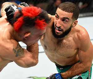 Belal Muhammad  punches <a href='../fighter/augusto-montano'><a href='../fighter/augusto-montano'>Augusto Montano</a></a> of Mexico in their welterweight bout during the <a href='../event/UFC-Silva-vs-Irvin'><a href='../event/UFC-Silva-vs-Irvin'>UFC Fight Night </a></a>event at State Farm Arena on September 17, 2016 in Hidalgo, Texas. (Photo by Josh Hedges/Zuffa LLC)