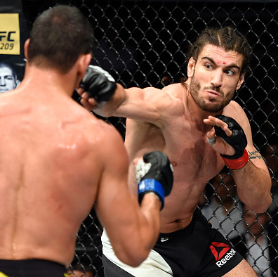 Elias Theodorou of Canada punches Cezar Ferreira of Brazil in their middleweight fight during the UFC Fight Night event inside the Scotiabank Centre on February 19, 2017 in Halifax, Nova Scotia, Canada. (Photo by Josh Hedges/Zuffa LLC)