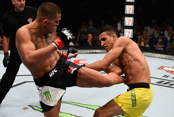 Anthony Pettis kicks <a href='../fighter/Charles-Oliveira'>Charles Oliveira</a> during his featherweight debut at Fight Night Vancouver in August