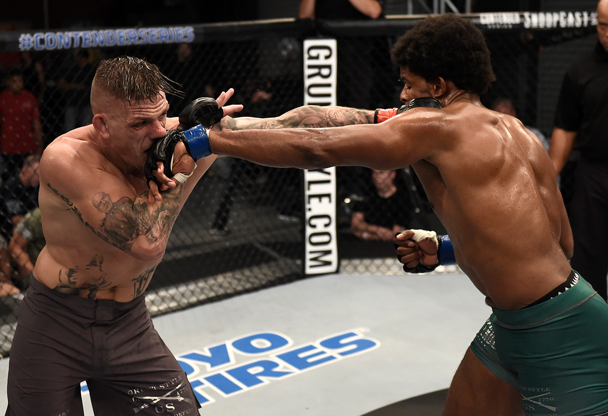 LAS VEGAS, NV - AUGUST 22:   (R-L) Kennedy Nzechukwu and Anton Berzin of Ukraine trade punches in their light heavyweight bout during Dana White's Tuesday Night Contender Series at the TUF Gym on August 22, 2017 in Las Vegas, Nevada. (Photo by Brandon Magnus/DWTNCS)