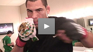 Cain Velasquez warms up before his fight against Jake O'Brien
