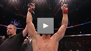 With less than a minute left in a close fight at UFC 115, Mike Pyle uses a leg triangle and elbows to end things.