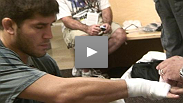 Cote, Lytle, Almeida get their hand wrapped before their fight.