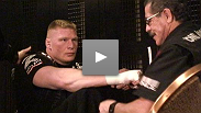 Brock Lesnar gets his hands wrapped before before his title fight