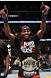 "UFC 128: Jon ""Bones"" Jones celebrates his win over Mauricio ""Shogun"" Rua and his new title belt"