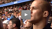 Heavyweight title contender Junior dos Santos watches the most recent championship fight in the division - he fights the winner Saturday night.