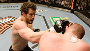 Nate Marquardt battles back from a nasty cut to finish Jeremy Horn with a guillotine choke at UFC 81.