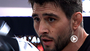 Former interim welterweight champion Carlos Condit interacts with fans and hits pads at the UFC 158 open workouts.