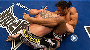 Benson Henderson retains the WEC lightweight title with a &#39;smooth&#39; guillotine choke of Donald Cerrone at WEC 48.
