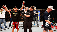 Rafael Dos Anjos won a controversial decision in a back-and-forth brawl with Evan Dunham. After the fight, a stitched-up Dos Anjos spoke with FUEL TV's Heidi Androl