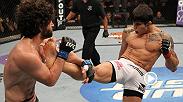 Erick Silva super en lucha al luchador Charlie Brenneman antes de asegurar un candado al cuello en UFC on FX 3.