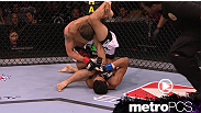 Charles Oliveira earns his first UFC win with a triangle/armbar combination.